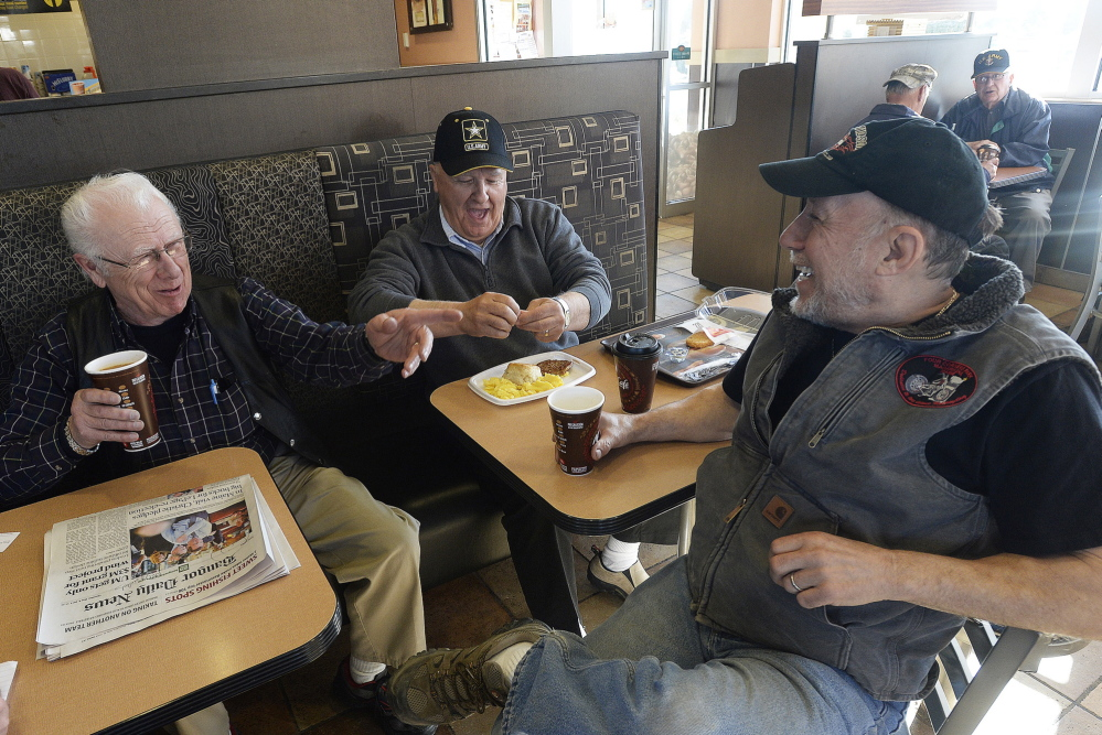 From left, Ray Campagna, 81, Earl Pelletier, 64, and Joe LaChance, 68, all of Madawaska, talk politics at the local McDonald's. The three men cited a variety of reasons, from religious to personal, for opposing Mike Michaud.