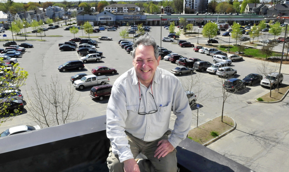 CUSTOMER SERVICE: Robert Sezak, owner of the Re-Books store in the Concourse in Waterville, says he believes parking spaces should be for customers first, not people who work at downtown businesses.