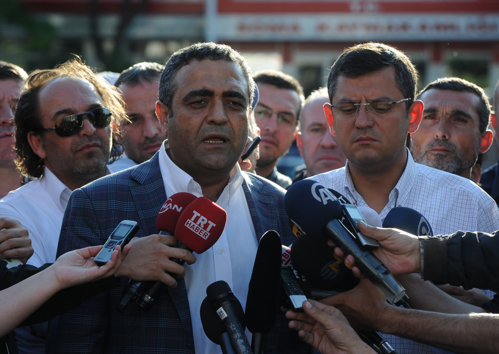 Opposition lawmakers Sezgin Tanrikulu, left, and Ozgur Ozel, right, speak to the media outside a local courthouse in the coal miners' town of Soma, Turkey, Sunday.