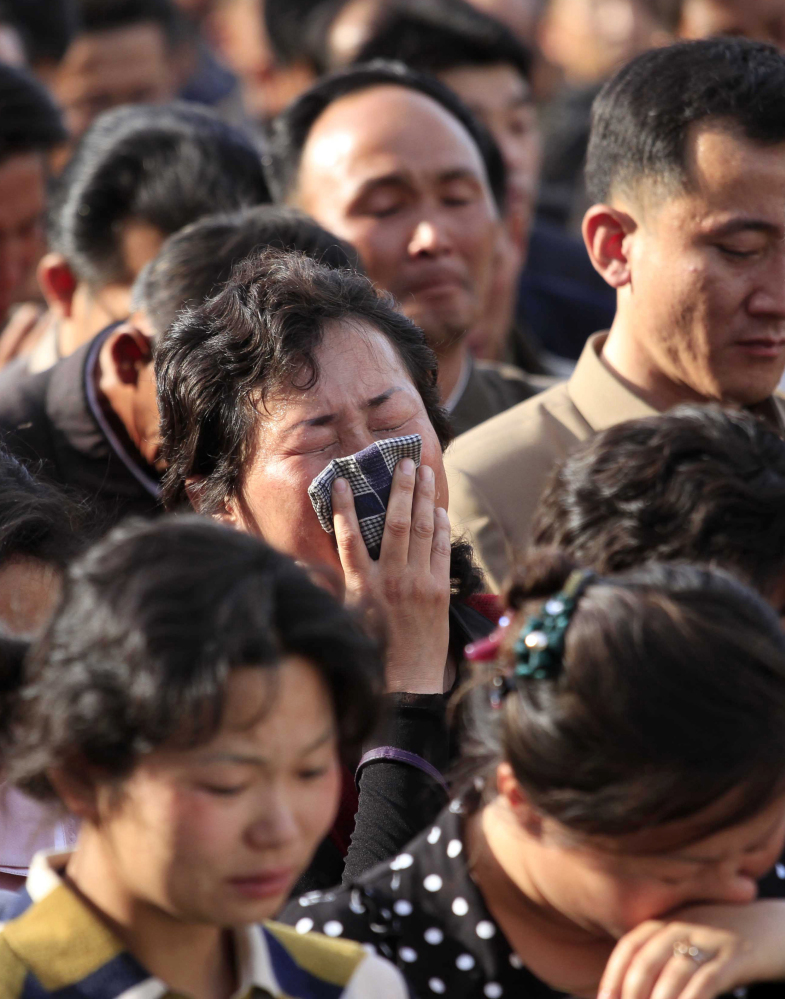 Families of victims of an accident at an apartment construction site in Pyongyang, North Korea, grieve during a gathering in the capital where senior officials apologized and took responsibility.