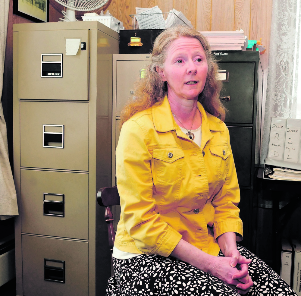 NEW MANAGER: Triss Smith speaks about her new job as Anson administrative assistant at the temporary town office on Monday. Smith will replace Bob Worthley, who is retiring.