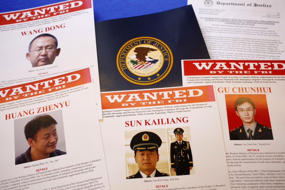 Wanted posters are displayed on a table of the Justice Department in Washington on Monday.