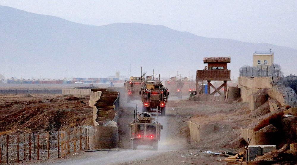 133rd: A group of gun trucks from the Convoy Escort Team of the 133rd Engineer Battalion of the Maine Army National Guard snake their way along the perimeter of Forward Operating Base Shank as they prepare to roll on a convoy to Bagram Air Field in December.