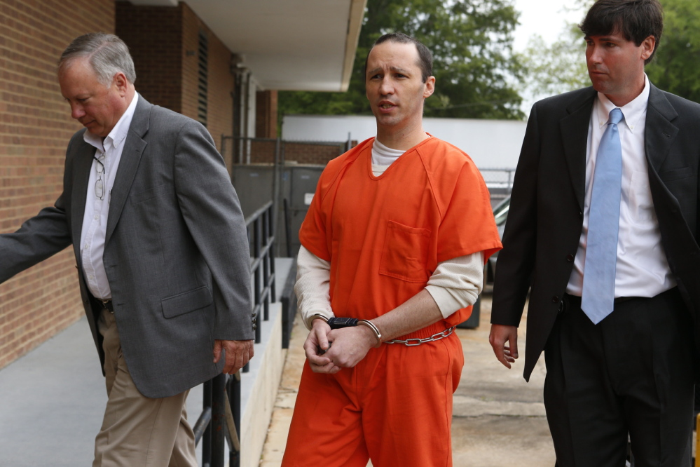 James Everett Dutschke is lead by U.S. marshals into the Federal Building in Aberdeen, Miss., on May 13.