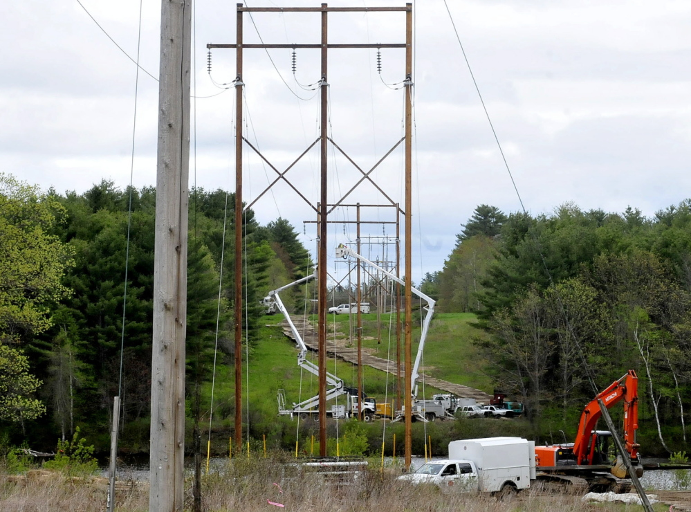 POWER UPGRADE: Utility employees work to upgrade Central Maine Power transmission lines in Skowhegan.