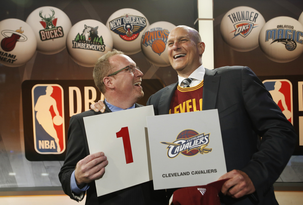 Cleveland Cavaliers general manager David Griffin, left, and minority owner Jeff Cohen celebrate after the Cavaliers won the top pick in the the NBA basketball draft lottery in New York, Tuesday, May 20, 2014. It's the third time in four years the Cavs will be atop the draft after moving up from the ninth spot.