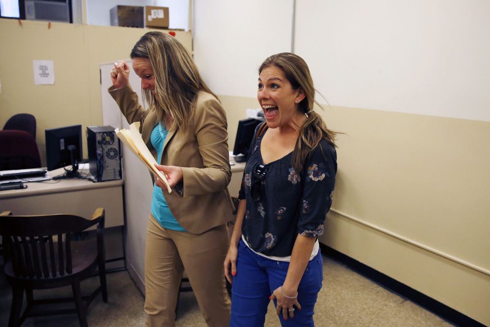 Ashley Wilson, left, and Lindsay Vandermay, right, both 29, react after getting their marriage license at the Philadelphia Marriage Bureau in City Hall, Tuesday, May 20, 2014, in Philadelphia. Pennsylvania's ban on gay marriage was overturned by a federal judge Tuesday.