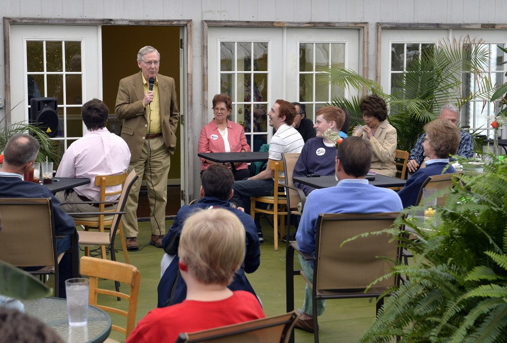 In this May 17, 2014, photo, Senate Republican leader Mitch McConnell speaks to a gathering of supporters at the Tanglewood Farms Restaurant in Franklin, Ky.