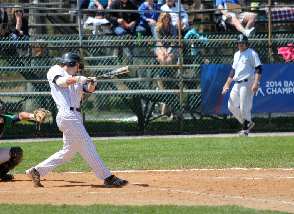 Forrest Chadwick, a Gardiner graduate, connects for a home run during the Div. III Eastern regional tournament last weekend. Chadwick is a big reason why the Huskies will play for the Div. III World Series.