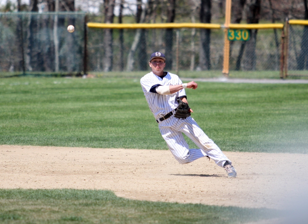 Sam Dexter, a Messalonskee graduate, fields a ground ball and throws to first base during an Eastern regional game last weekend. Dexter and the Huskies are off to the Division III college world series.