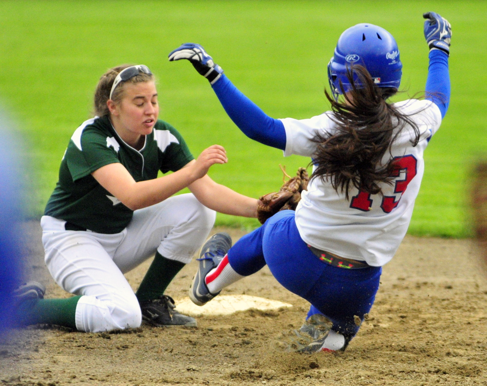 SAFE: Winthrop shortstop Lily Ouellette tries to tag out Oak Hill baserunner Jamie Prue Tuesday.