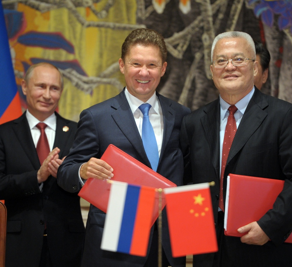 Russia's President Vladimir Putin, left, applauds during a signing ceremony in Shanghai, China, on Wednesday, while Russian Gazprom CEO Alexei Miller, second left, and China's CNPC head Zhou Jiping hold documents.