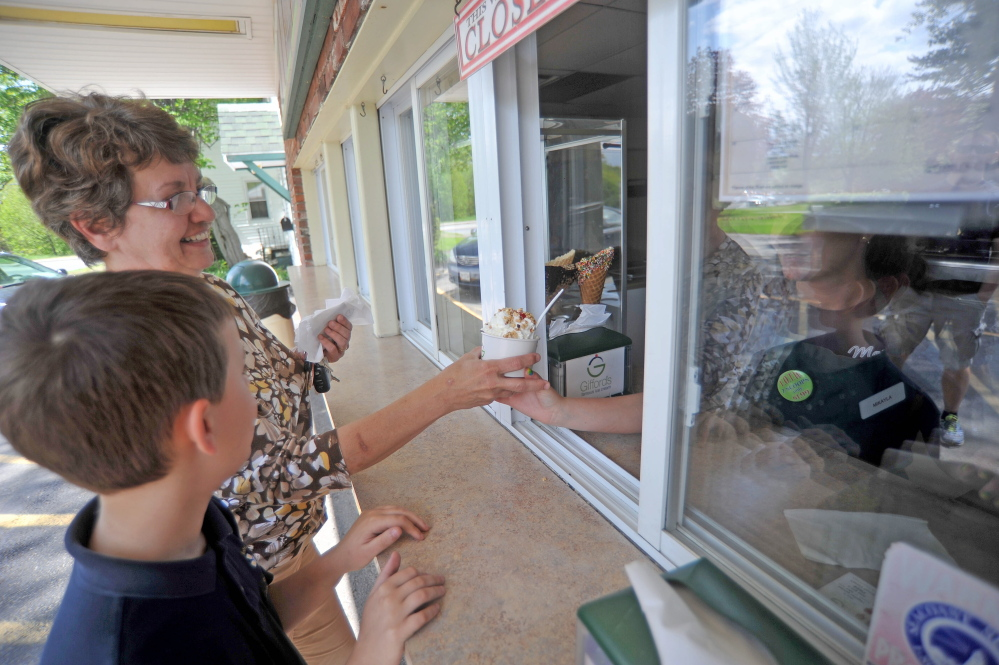HOME-GROWN TREAT: Marge Veilleux and her grandson Nolan, 9, order ice cream at Gifford's Ice Cream on Thursday afternoon on Silver Street in Waterville.