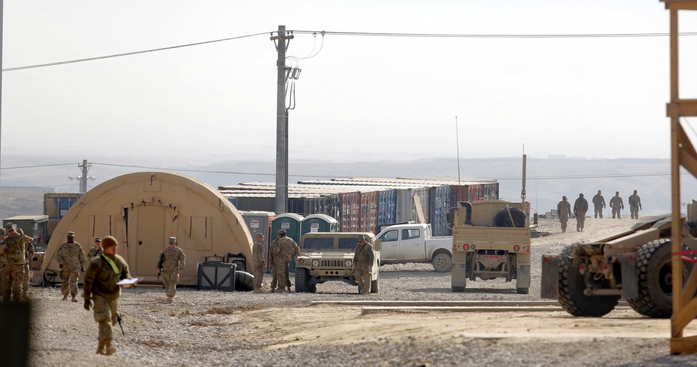 Soldiers work near the headquarters of the 133rd Engineer Battalion of the Maine Army National Guard last year at Bagram Airfield in Afghanistan.
