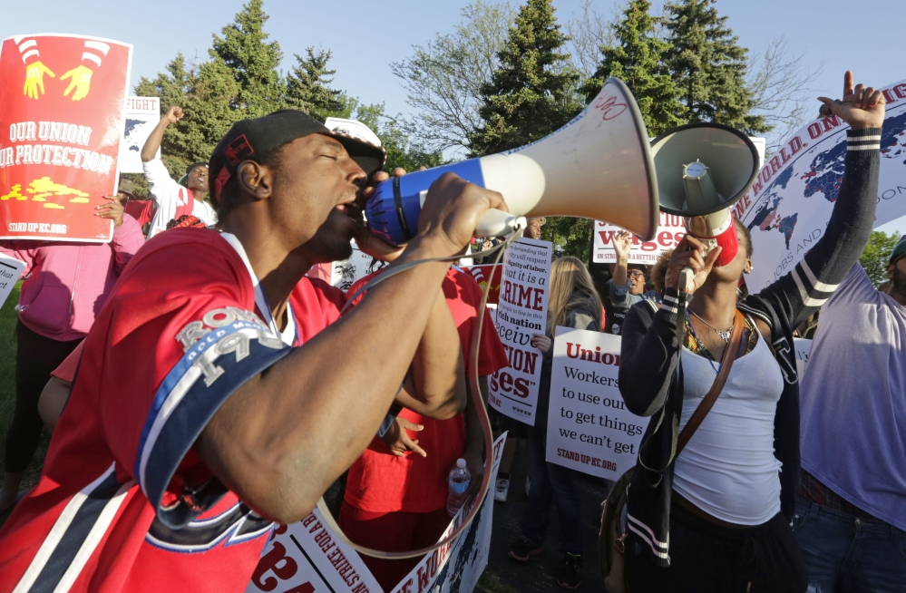 Hundreds of protesters gather outside of the McDonald's Corp. Thursday in Oak Brook, Ill., demonstrating for a $15 hourly wage and the right to unionize. The group gathered outside the entrance to the company's headquarters during the annual shareholders meeting.
