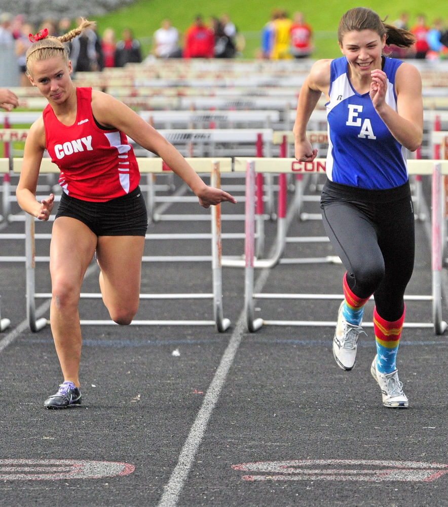 Staff photo by Joe Phelan FIGHT TO THE FINISH: Erskine Academy's Jade Canak, right, leads Cony's Madeline Reny to win the 100 meter hurdles during Capital City Classic.