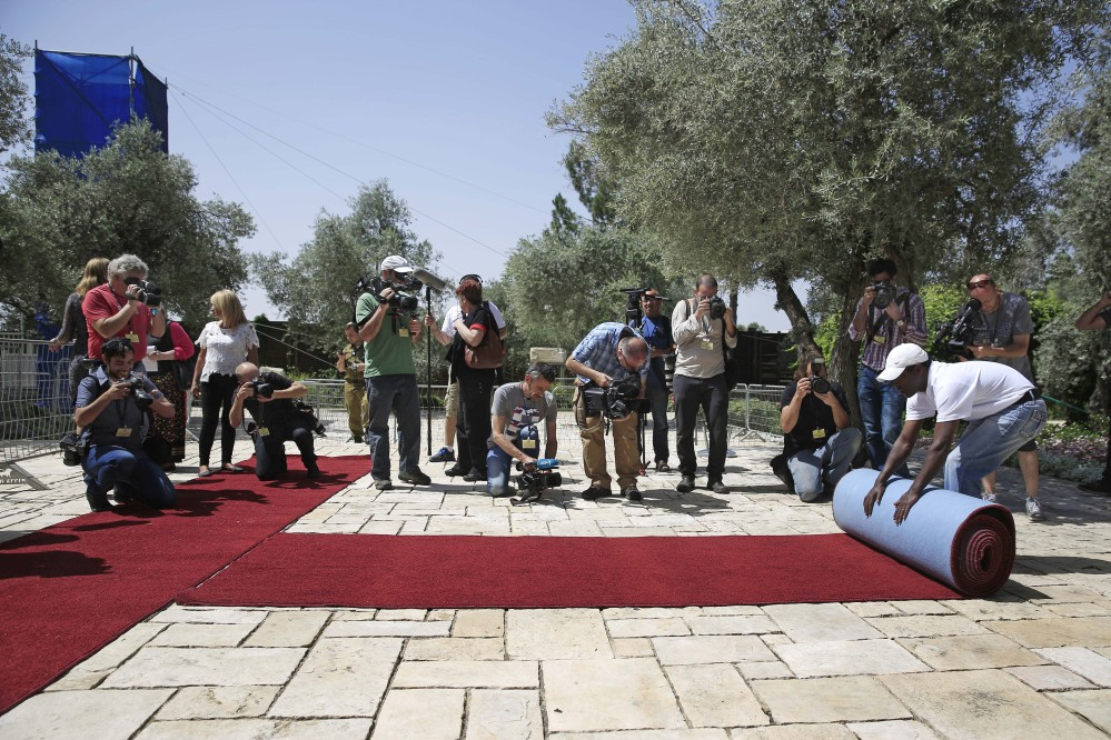 A red carpet is unrolled at the Israeli president's residence in preparation for the Papal visit to Jerusalem.