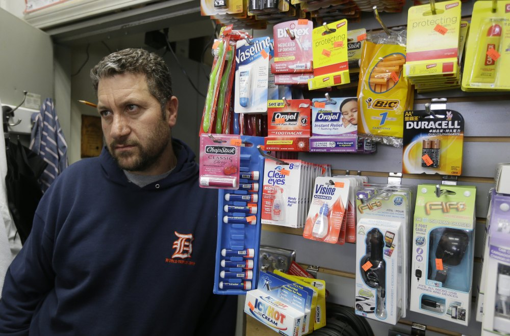 Mousa Bazzi, who owns a Mobil station in a semi-desolate neighborhood bordering Detroit's east riverfront, participates in the city's anti-carjacking effort. To be part of the program, stations must have working security cameras, good lighting, be open 24 hours and have clerks willing to help motorists and provide a phone for emergency calls.