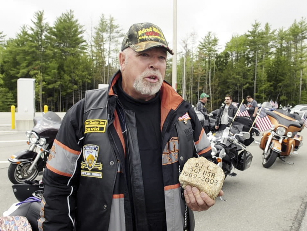 RECALLING A SOLDER: David Boyd talks about Army Sgt. Daniel Cunningham's stone during a stopover by The Summit Project convoy on Friday at the West Gardiner rest area off the Maine Turnpike.