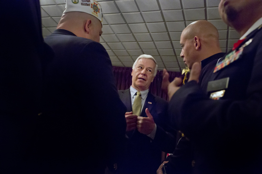At VFW Deering Memorial Post 6859 in Portland on Friday, Democratic U.S. Rep Mike Michaud, seen with post Commander Steven San Pedro, left, and David Price, called for reform of the Department of Veterans Affairs. His opponents, Gov. Paul LePage and independent Eliot Cutler, said Congress has long ignored problems at the VA.