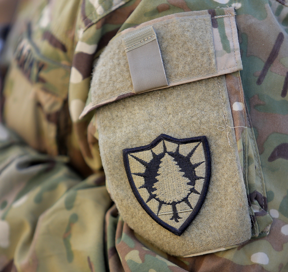 A pine tree patch denotes the 133rd Engineer Battalion of the Maine Army National Guard.