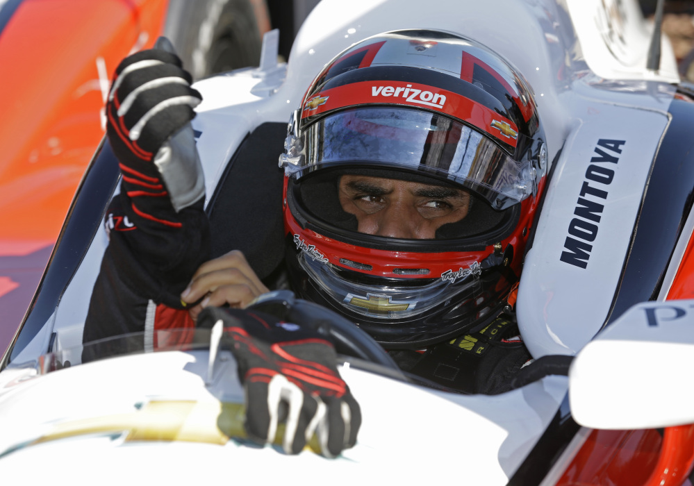 I got this: Juan Pablo Montoya puts on his gloves as he prepares at a recent practice for the Indianapolis 500 at the Indianapolis Motor Speedway in Indianapolis. The 98th running of the Indianapolis 500 is Sunday.