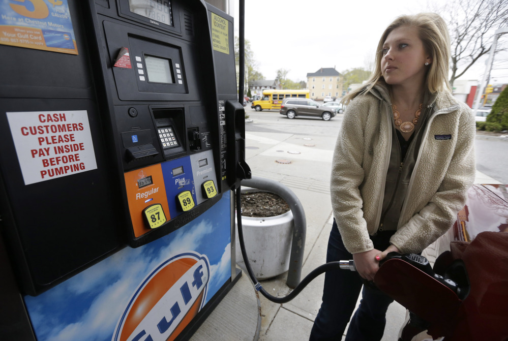 Katie Spillane of Brookline, Mass., fills her car with fuel at a gas station in Brookline. If the price of gasoline looks familiar this Memorial Day, that's because it is.