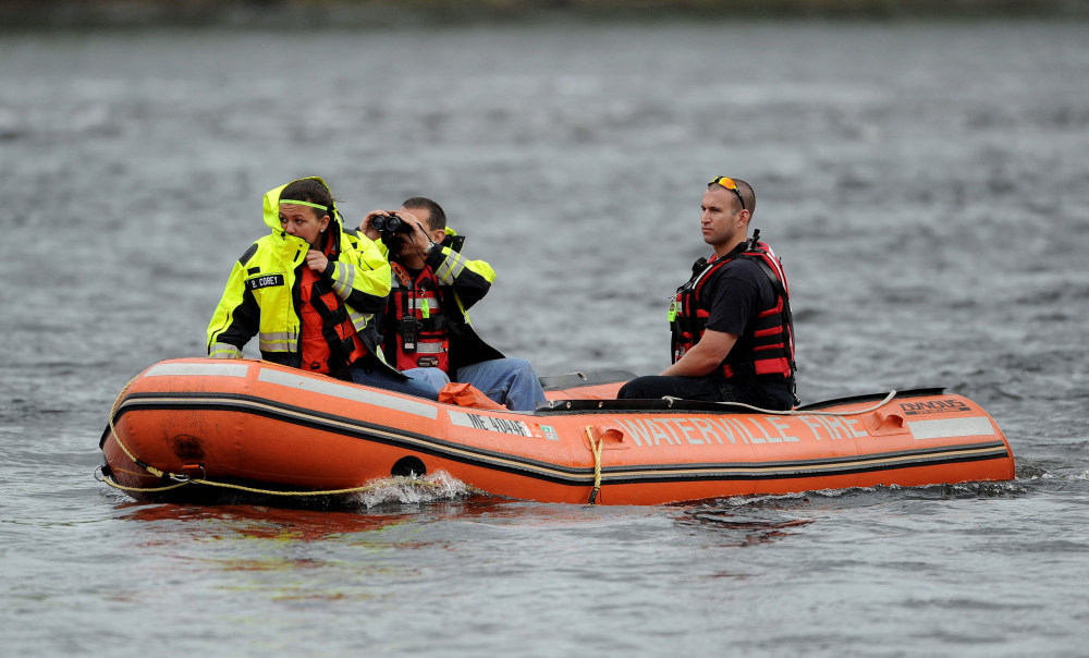 Eyes on the water: A Waterville fire department crew searches the Kennebec River on Saturday near the Hathaway Creative Center for a person reported likely to be in the water.
