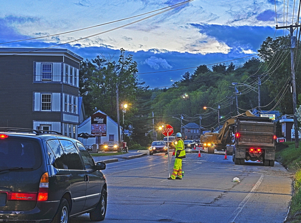 Flagged down: Flaggers alternate the direction of traffic flow in one lane through an overnight construction zone Wednesday on Mount Vernon Avenue in Augusta.