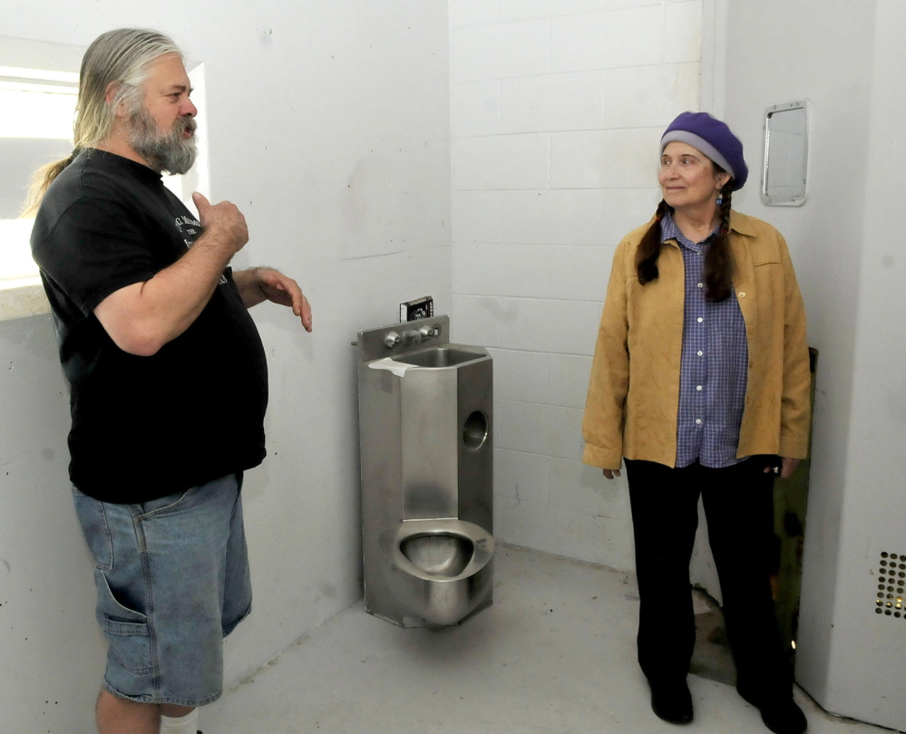 JAIL HOUSE ROCK: Timothy Smith and Annie Stillwater Gray speak on Thursday about plans to transform cellblock E13 into a noncommercial and community based radio station at the former Somerset County Jail in Skowhegan. The object in background is a combination toilet and sink used by inmates.