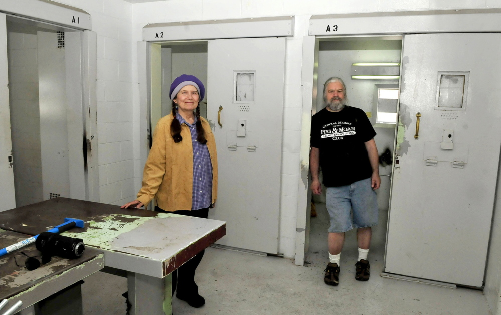 MUSICAL CELL: Annie Stillwater Gray, of the Wesserunsett Arts Council, and program engineer Timothy Smith, shown Thursday, discuss plans to convert cellblock E13 at the former Somerset County Jail in Skowhegan into a noncommercial and community-based radio station: 98.1.