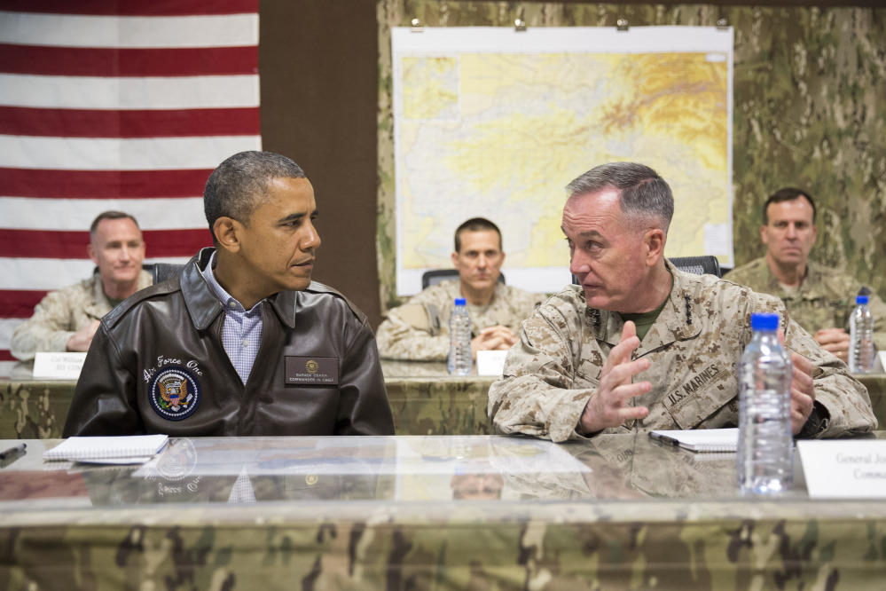 President Barack Obama gets a briefing by Marine Gen. Joseph Dunford, commander of the U.S.-led International Security Assistance Force, right, after arriving at Bagram Air Field for an unannounced visit Sunday.