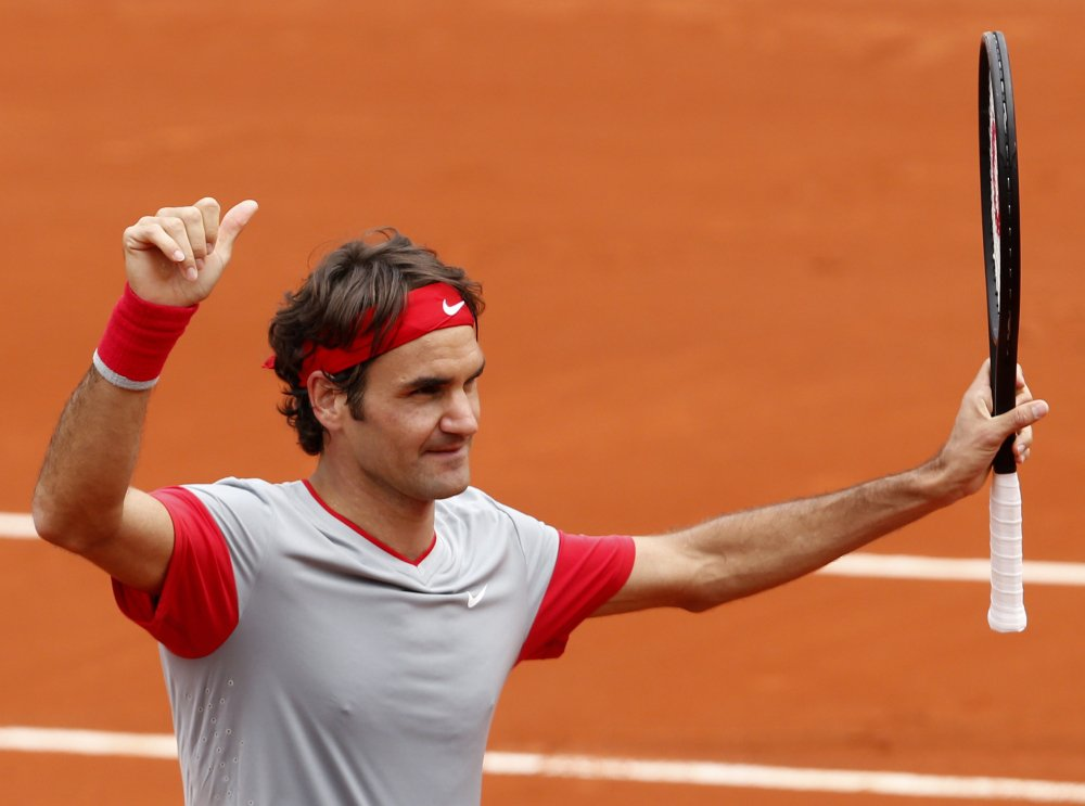 Roger Federer gives the thumbs up after defeating Lukas Lacko in the first-round match of the French Open tennis tournament at the Roland Garros stadium, in Paris, France, on Sunday. Federer won 6-2, 6-4, 6-2.