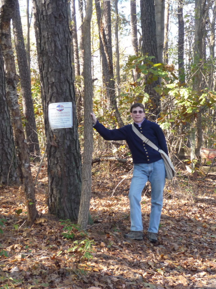 Not Quite a Grave: Tracey McIntire, descendant of Maine Civil War veteran Joseph Herrick, is standing in the Petersburg, N.C. area site of the Battle of Preebles's Farm, which is where Herrick was captured before being sent to the prison in which he would die.