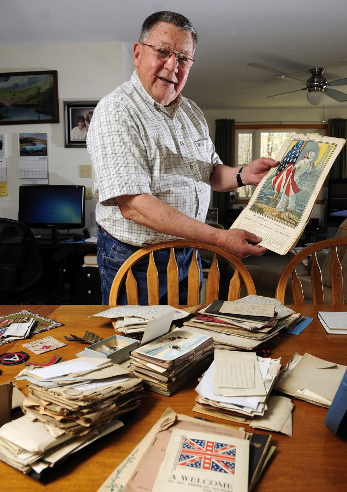 Memorabilia: Jim Wood looks over memorabilia from his late uncle Leon Wood recently in his Winthrop home.