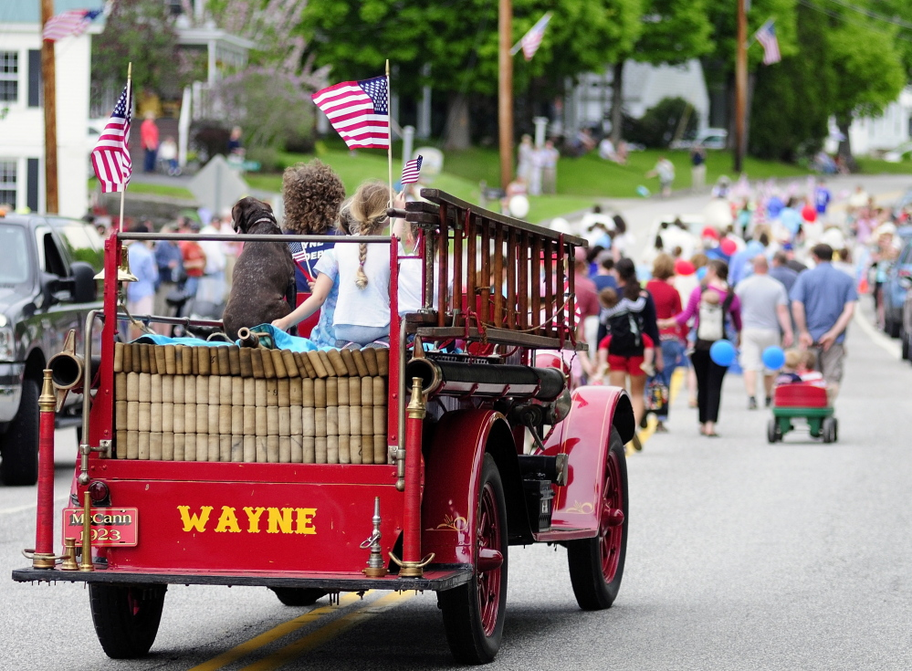 The Wayne Fire Department's antique 1923 McCann fire truck drives down Main Street during the Memorial Day parade Monday.