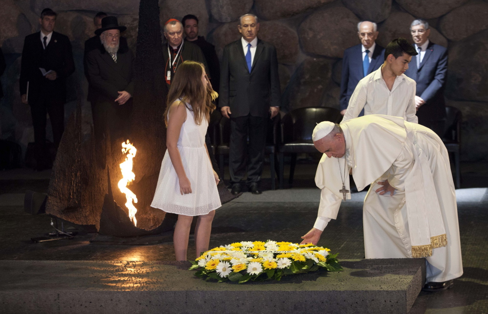 Pope Francis lays a wreath the Hall of Remembrance at the Yad Vashem Holocaust memorial in Jerusalem on Monday, as he concluded his three-day Mideast trip.