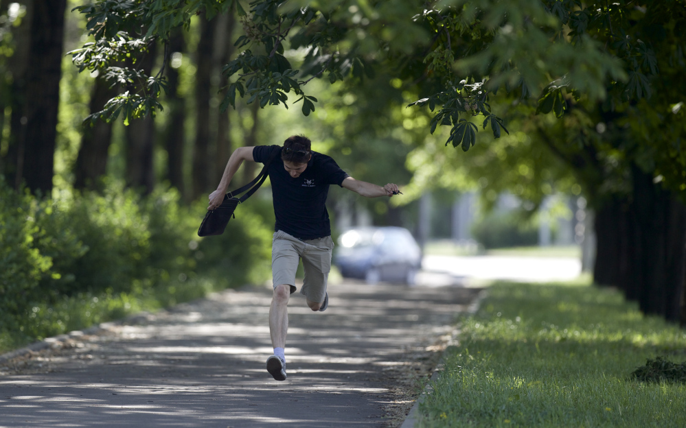 A local resident runs for cover during fighting around the airport, outside Donetsk, Ukraine, on Monday. Ukraine's military launched air strikes Monday against separatists who had taken over the airport in the eastern capital in what appeared to be the most visible operation of the Ukrainian troops since they started a crackdown on insurgents last month.