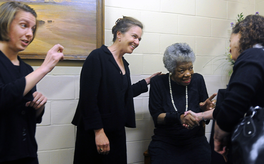 ANGELOU VISIT: Maya Angelou, second from right, greets Brenda Schertz, right, Marissa Zastrow, left, and Margaret Haberman, second from left, before Angelou's presentation April 26, 2010 in Augusta. The University of Maine at Augusta sponsored the poet's visit.