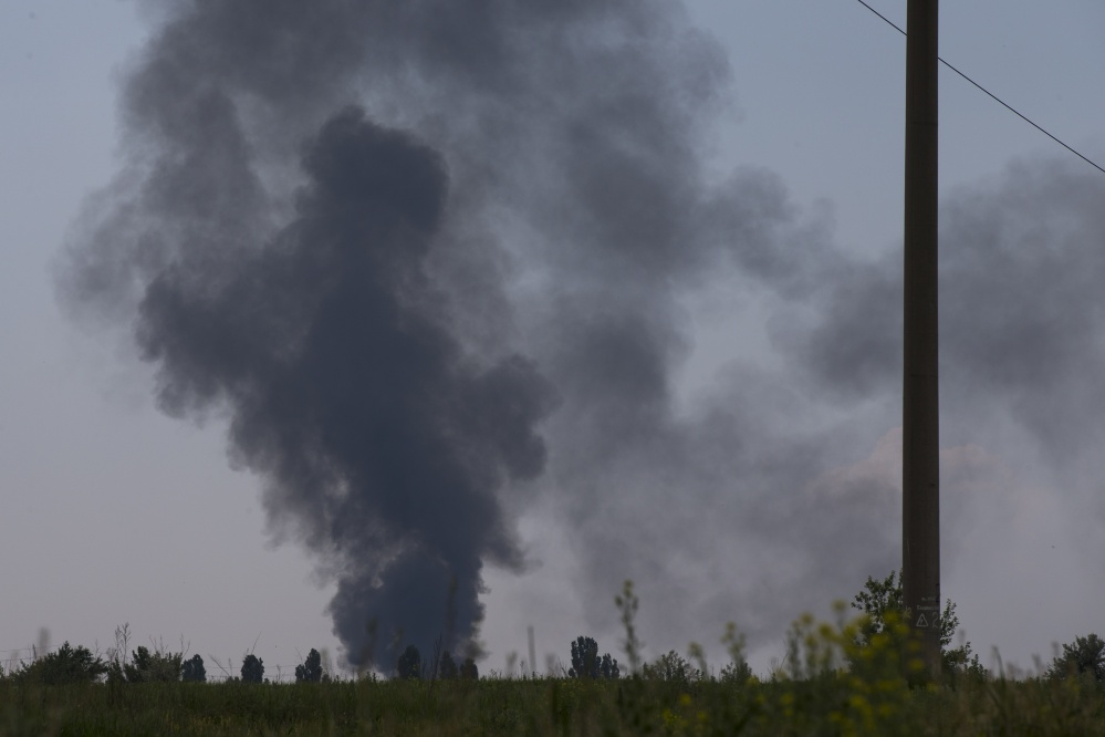 Black smoke rises from a shot-down Ukrainian Army helicopter outside Slovyansk, Ukraine, on Thursday.