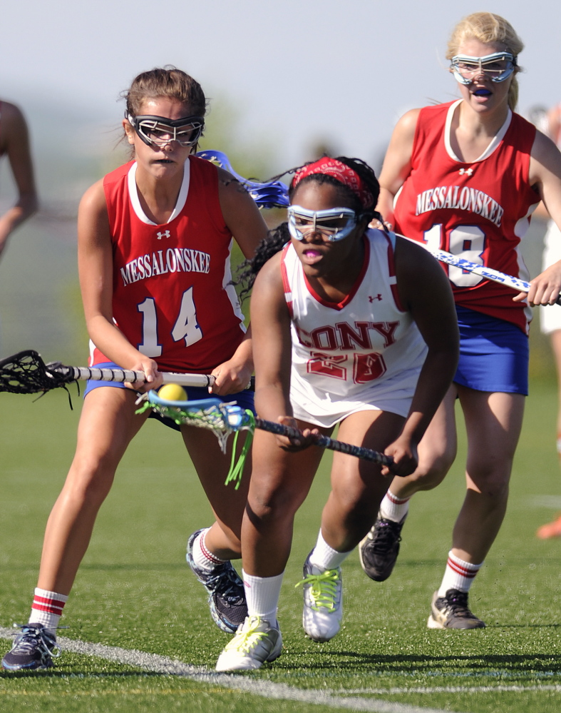 Staff photo by Andy Molloy UNDER PRESSURE: Cony's Tynisha Francois, center, collects the ball between Messalonskee's India Languet, left, and Nathalia St. Pierre Thursday in Readfield.