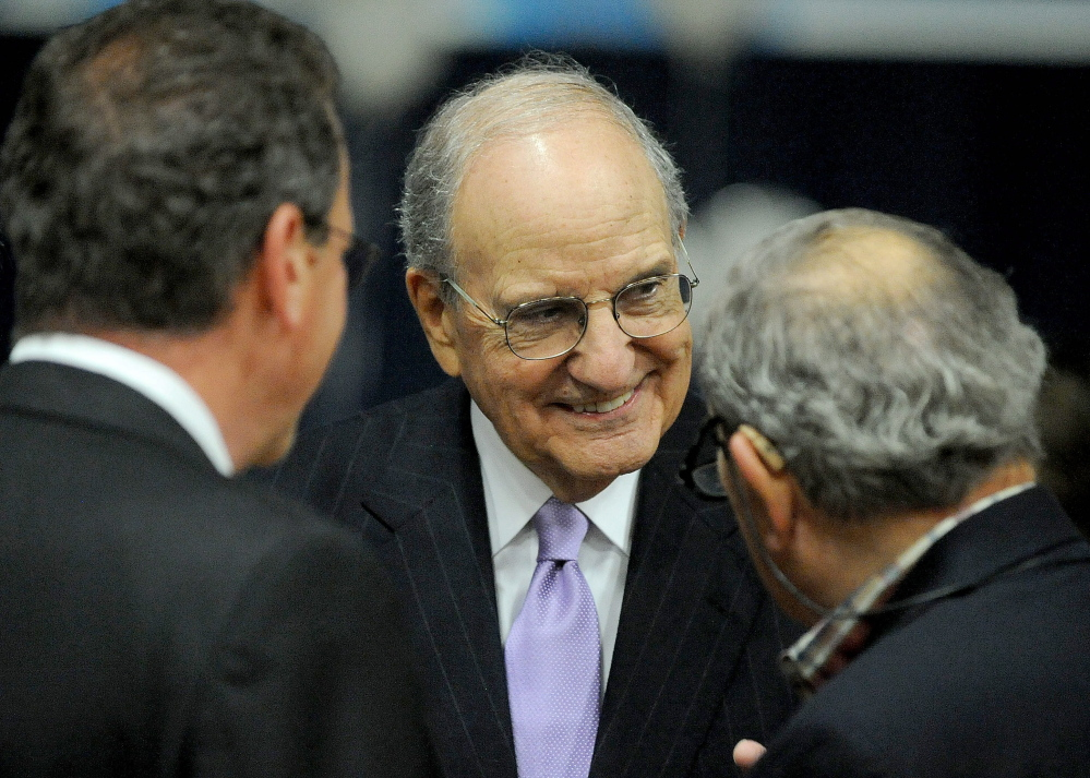 BACK IN TOWN: Former U.S. Sen. George Mitchell talks with people gathered at the Boys and Girls Club 90th anniversary celebration at the Alfond Youth Center in Waterville on Friday.