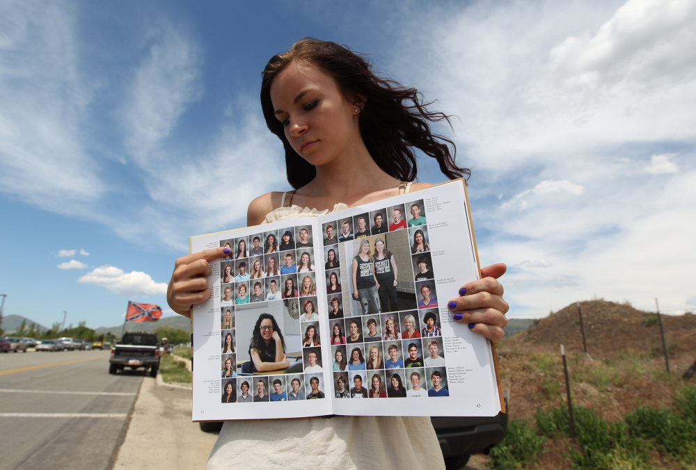 Wasatch High School sophomore Kimberly Montoya, 16, points to her altered school yearbook photo in Heber City, Utah.