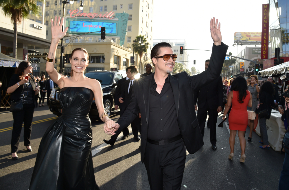 "In this Wednesday, May 28, 2014 file photo, Angelina Jolie, left, and Brad Pitt arrive at the world premiere of ""Maleficent"" at the El Capitan Theatre in Los Angeles. A man who accosted Pitt on a red carpet has pleaded no contest to battery and been ordered to stay away from the actor and Hollywood red carpet events. Vitalii Sediuk entered the plea during a Los Angeles court appearance Friday, May 30, 2014, two days after he leaped from a fan area and made contact with Pitt at the ""Maleficent"" premiere."