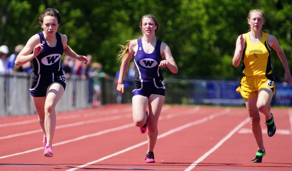 Runners: Waterville sprinters Amy Samson, left, Katherine Vince and Maranacook's Lindsay Perkins head toward the 200 meter dash finish line during the KVAC track meet on Saturday in Bath.