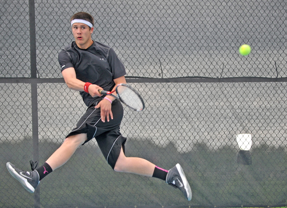 Tennis: Monmouth Academy's Kasey Smith returns a shot from Waterville Senior High School's Zack Disch at the Round of 48 singles tournament hosted by Colby College in Waterville on Saturday. Disch defeated Smith, 3-6, 6-3, 6-3.