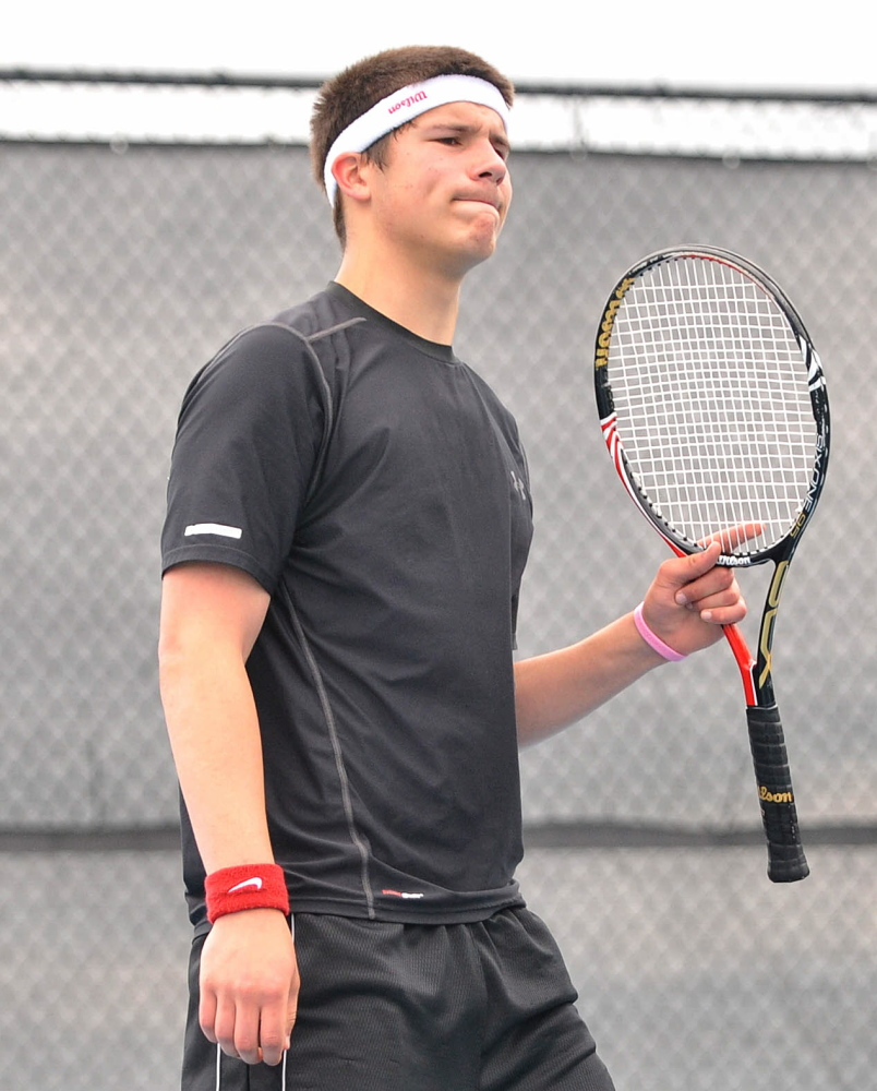 Loss: Monmouth Academy's Kasey Smith reacts after losing a point to a Waterville Senior High School's Zack Disch at the Round of 48 singles tournament hosted by Colby College in Waterville on Saturday. Disch defeated Smith, 3-6, 6-3, 6-3.