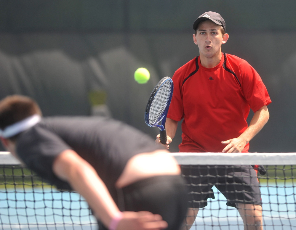 Hitter: Waterville Senior High School's Zack Disch returns a shot from Monmouth Academy's Kasey Smith at the Round of 48 singles tournament hosted by Colby College in Waterville on Saturday. Disch defeated Smith, 3-6, 6-3, 6-3.