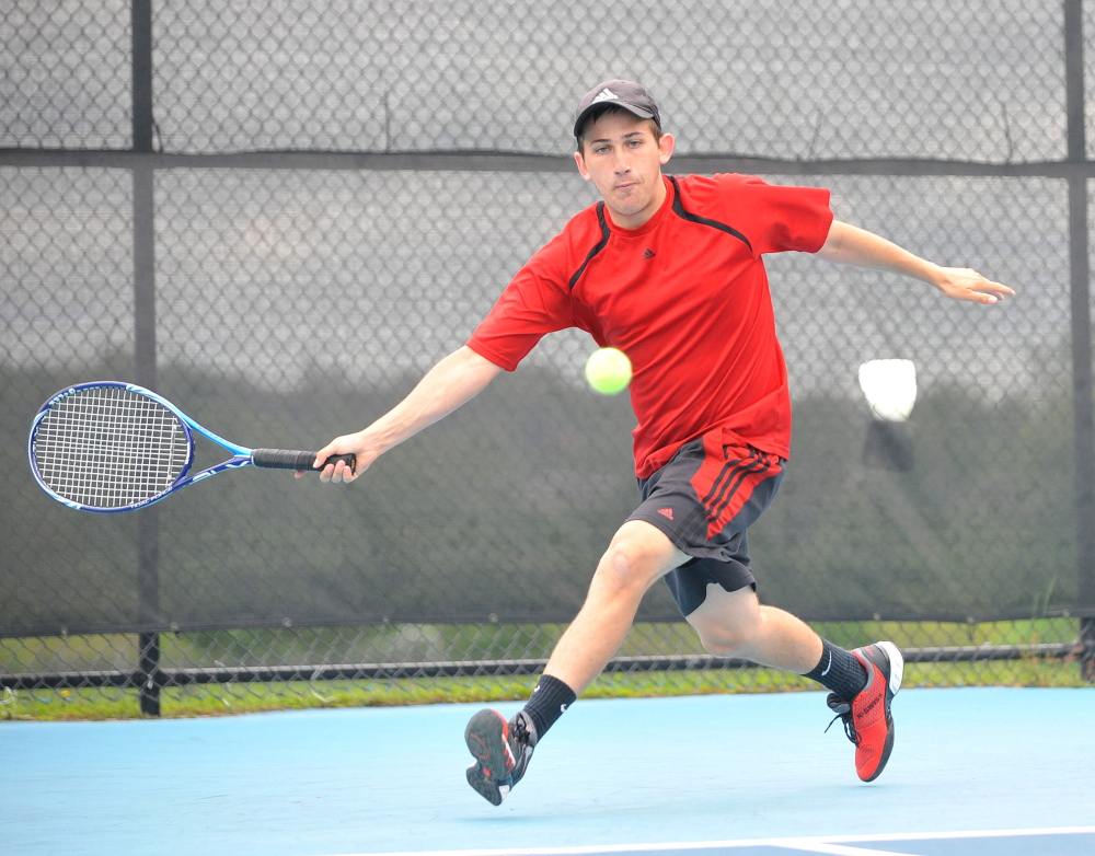Return: Waterville Senior High School's Zack Disch returns a shot from Monmouth Academy's Kasey Smith at the Round of 48 singles tournament hosted by Colby College in Waterville on Saturday. Disch defeated Smith, 3-6, 6-3, 6-3.