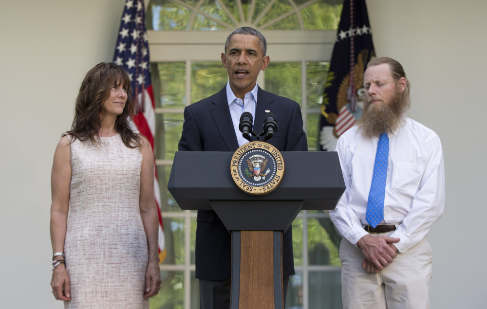 President Barack Obama speaks with Jani Bergdahl, left, and Bob Bergdahl, right, in the Rose Garden of the White House in Washington on Saturday after the announcement that their son, U.S. Army Sgt. Bowe Bergdahl, was released from captivity.